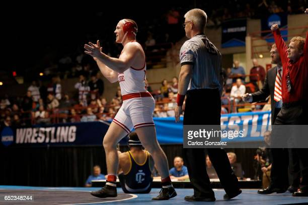 Riley Lefever of Wabash celebrates after beating Carlos Toribio of Ithaca in the 197 weight class during NCAA Division III Men's Wrestling...