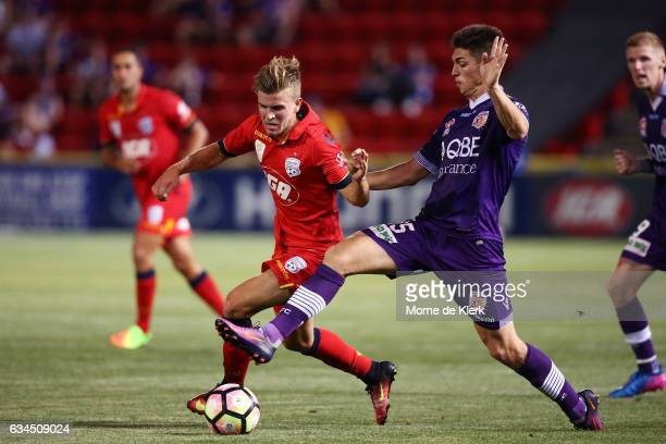 Riley McGree of Adelaide United competes with Brandon Wilson of Perth Glory during the round 19 ALeague match between Adelaide United and Perth Glory...