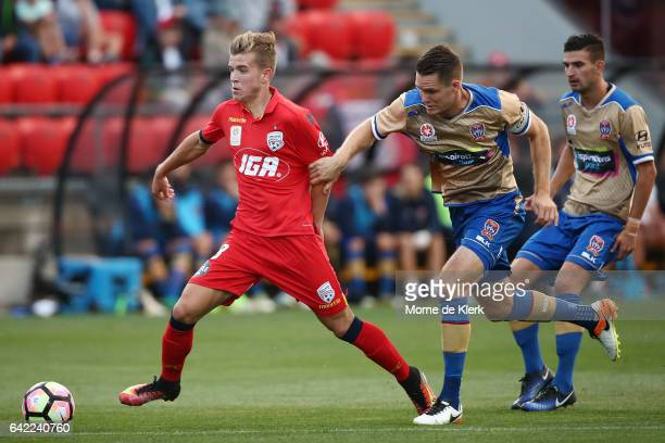 Riley McGree of Adelaide United gets away from Nigel Boogaard of the Jets during the round 20 ALeague match between Adelaide United and the Newcastle...