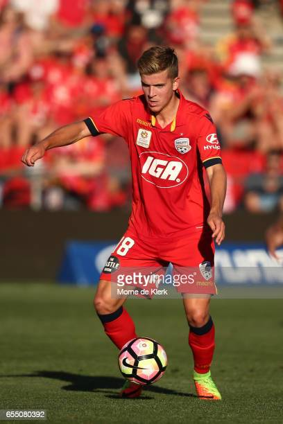 Riley McGree of Adelaide United kicks the ball during the round 23 ALeague match between Adelaide United and the Brisbane Roar at Coopers Stadium on...
