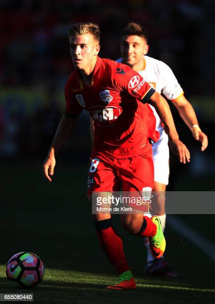 Riley McGree of Adelaide United runs with the ball during the round 23 ALeague match between Adelaide United and the Brisbane Roar at Coopers Stadium...