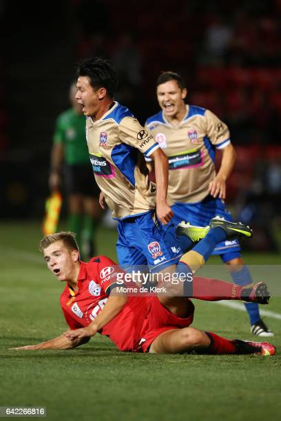 Riley McGree of Adelaide United tackles Lei Lei Ma of the Jets to spark an allin melee between the two sides during the round 20 ALeague match...