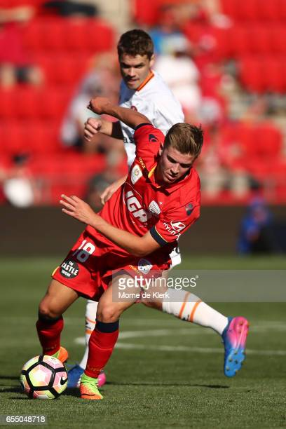 Riley McGree of Adelaide United wins the ball during the round 23 ALeague match between Adelaide United and the Brisbane Roar at Coopers Stadium on...