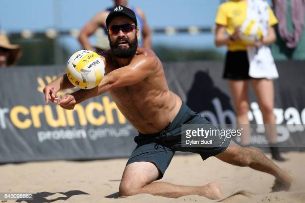 Riley McKibbin attempts a dig during his match against Lorenz Gardena and Chaim Schalk at the AVP Championships in Chicago Day 3 on September 2 2017...