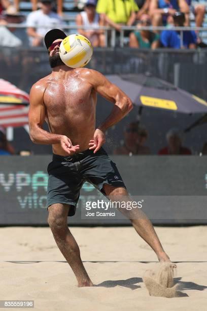 Riley McKibbin digs a fast ball in his round 4 match at the AVP Manhattan Beach Open Day 3 on August 19 2017 in Manhattan Beach California