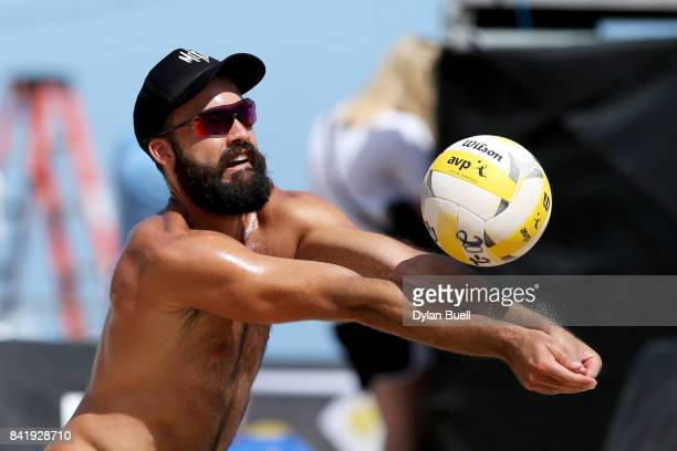 Riley McKibbin digs the ball during his match against Marty Lorenz and Chaim Schalk at the AVP Championships in Chicago Day 3 on September 2 2017 in...