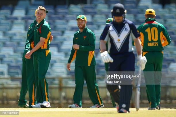 Riley Meredith of the Tigers celebrates the wicket of Travis Dean of the Bushrangers during the JLT One Day Cup match between Victoria and Tasmania...