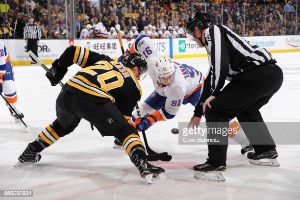 Riley Nash of the Boston Bruins faces off against John Tavares of the New York Islanders at the TD Garden on December 9 2017 in Boston Massachusetts