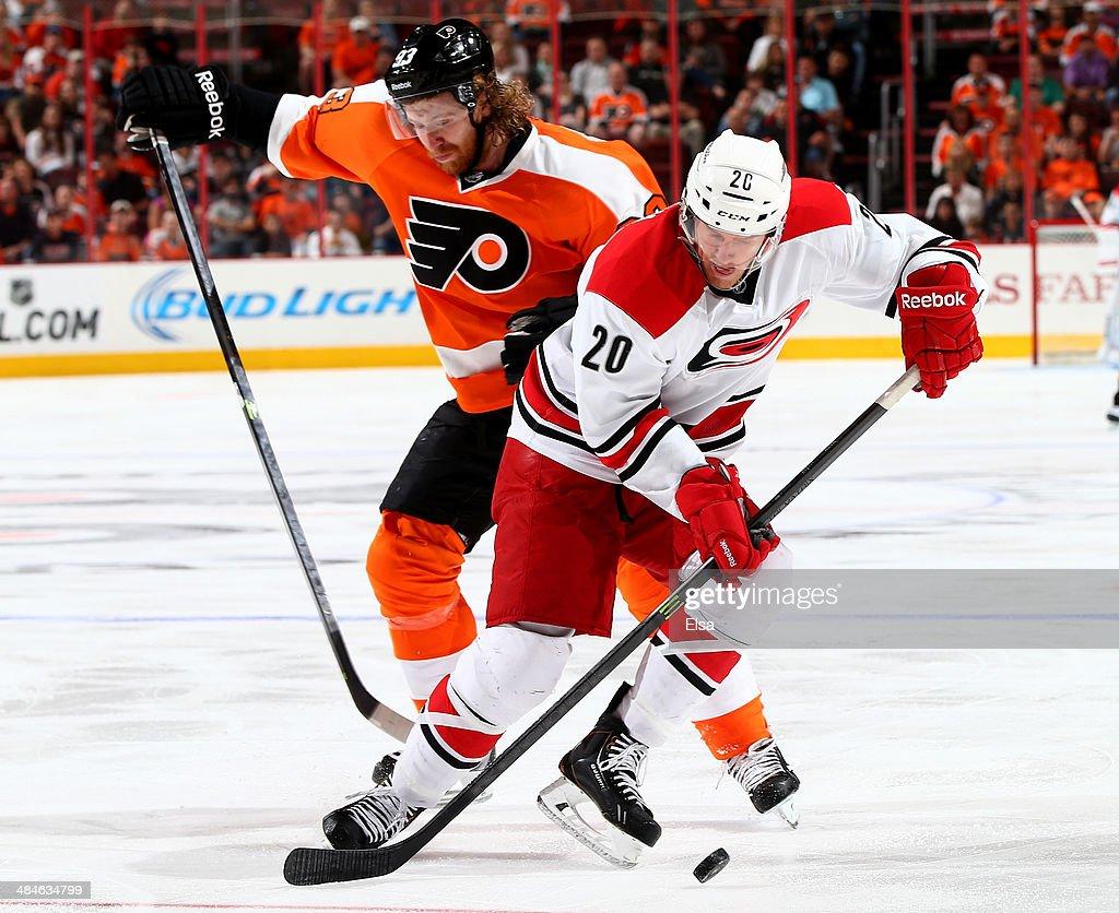 Riley Nash #20 of the Carolina Hurricanes and Jakub Voracek #93 of the Philadelphia Flyers collide in the first period at Wells Fargo Center on April 13, 2014 in Philadelphia, Pennsylvania.
