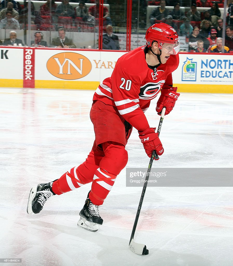 Riley Nash of the Carolina Hurricanes carries the puck during their NHL game against the Buffalo Sabres at PNC Arena on January 8 2015 in Raleigh...