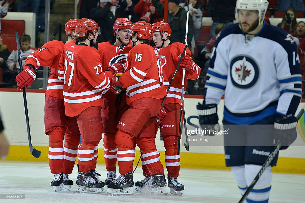 <a gi-track='captionPersonalityLinkClicked' href=/galleries/search?phrase=Riley+Nash&family=editorial&specificpeople=4324981 ng-click='$event.stopPropagation()'>Riley Nash</a> #20 of the Carolina Hurricanes celebrates with teammates following a goal during their game against the Winnipeg Jets at PNC Arena on February 4, 2013 in Raleigh, North Carolina. The Jets defeated the Hurricanes 2-1.