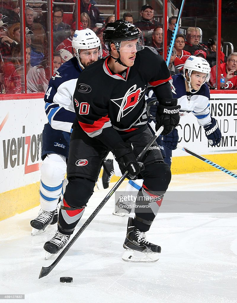 Riley Nash of the Carolina Hurricanes controls the puck on the ice against the Winnipeg Jets during their NHL game at PNC Arena on November 13 2014...