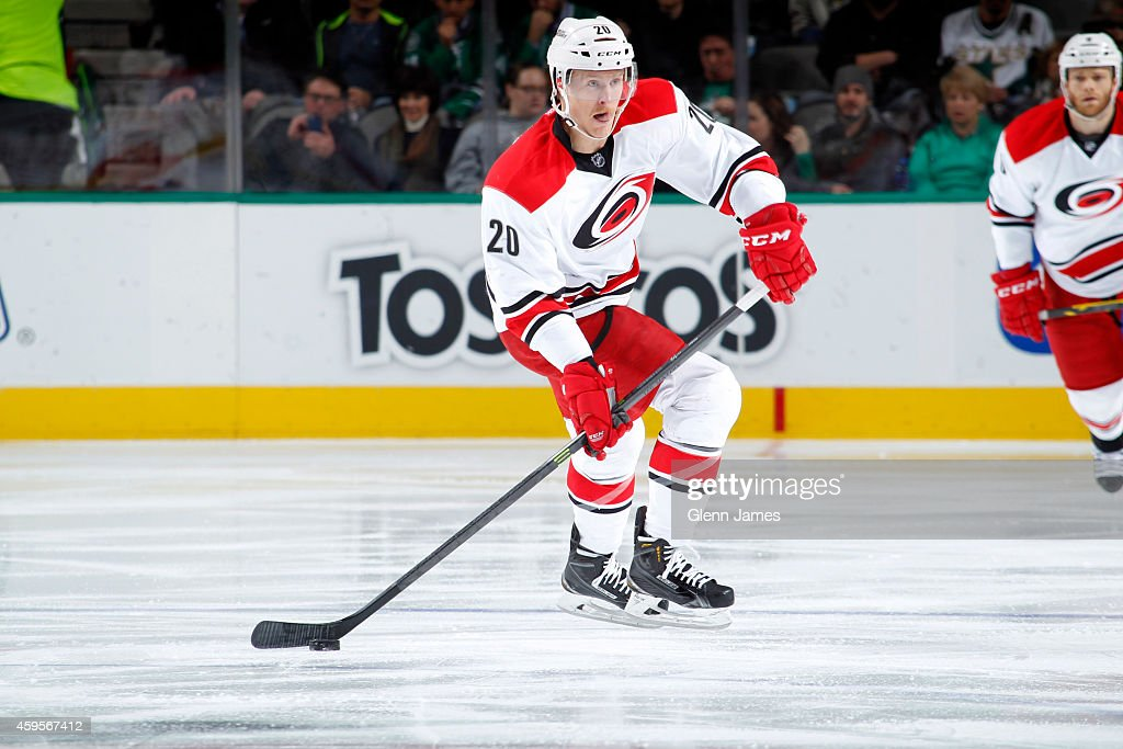 Riley Nash of the Carolina Hurricanes handles the puck against the Dallas Stars at the American Airlines Center on November 18 2014 in Dallas Texas