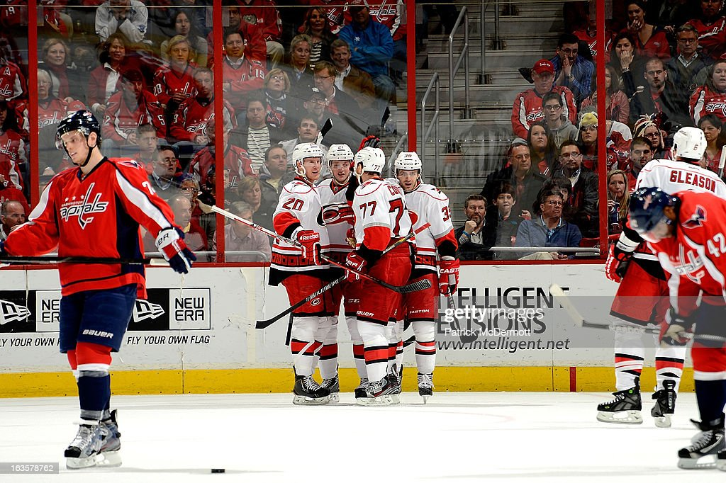 Riley Nash #20 of the Carolina Hurricanes is congratulated by teammates after scoring in the second period of an NHL game against the Washington Capitals at Verizon Center on March 12, 2013 in Washington, DC.