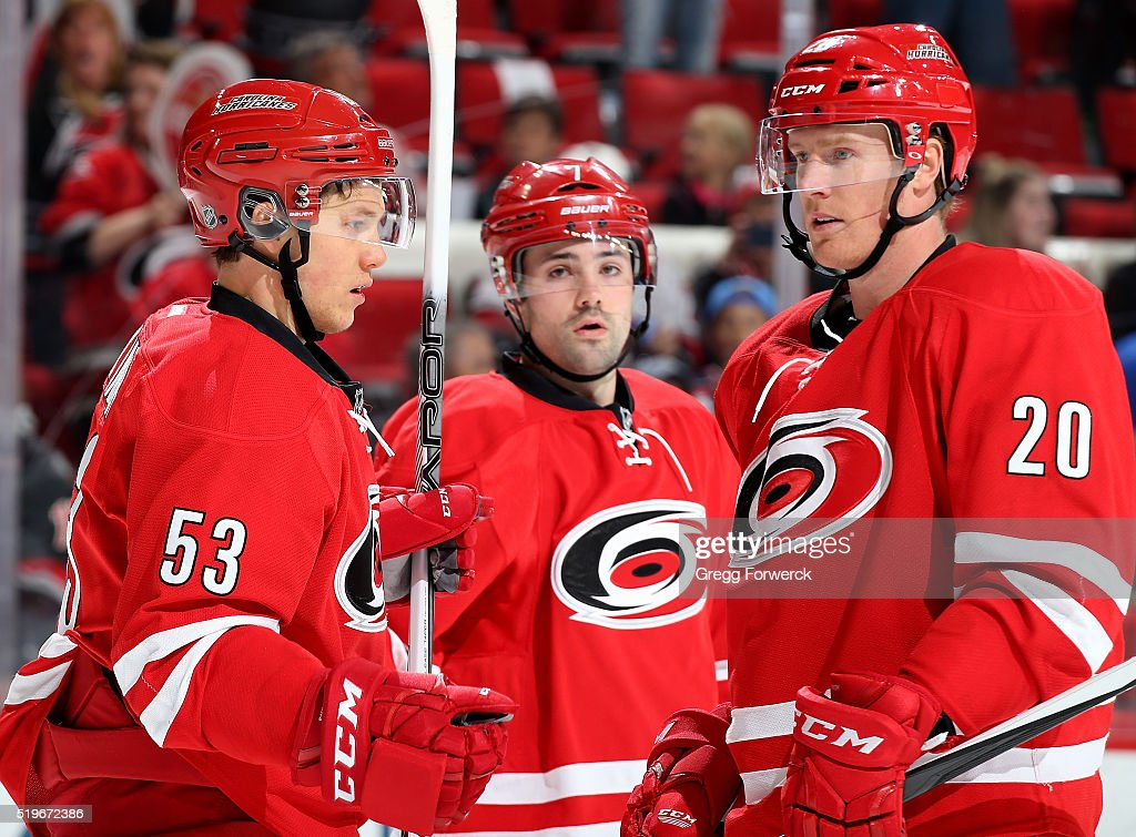 Riley Nash of the Carolina Hurricanes is congratulated on his first period goal by teammates Jeff Skinner and Ryan Murphy during an NHL game against...