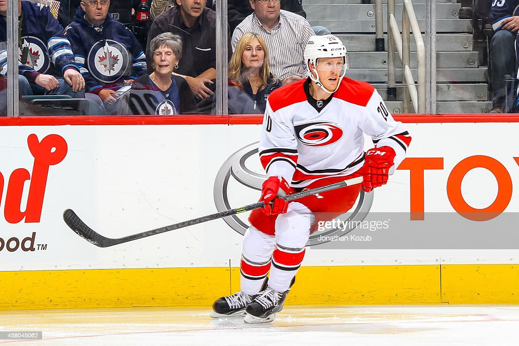 Riley Nash of the Carolina Hurricanes keeps an eye on the play during first period action against the Winnipeg Jets on October 21 2014 at the MTS...