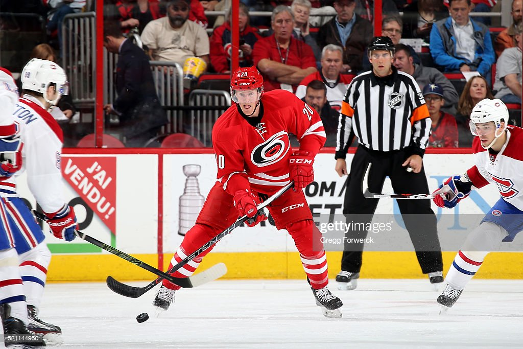 Riley Nash of the Carolina Hurricanes passes the puck during an NHL game agaisnt the Montreal Canadiens at PNC Arena on April 7 2016 in Raleigh North...
