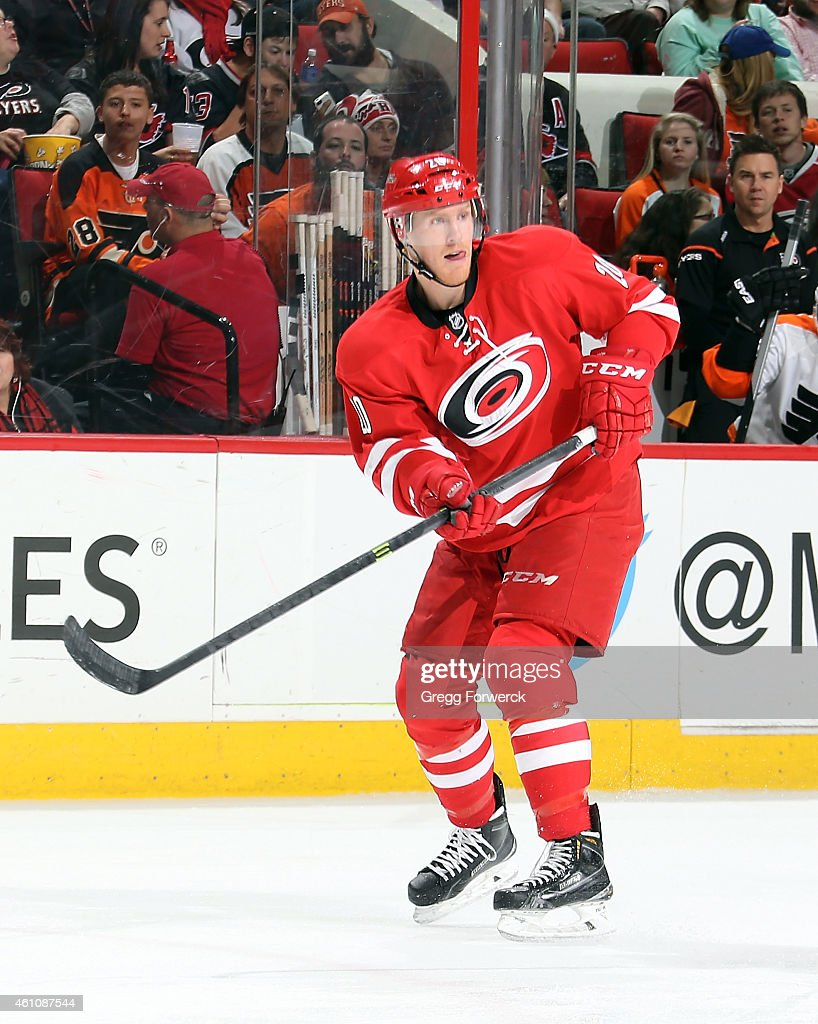 Riley Nash of the Carolina Hurricanes passes the puck during their NHL game against the Philadelphia Flyers at PNC Arena on January 2 2015 in Raleigh...