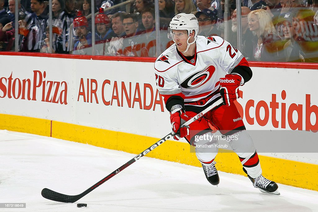 <a gi-track='captionPersonalityLinkClicked' href=/galleries/search?phrase=Riley+Nash&family=editorial&specificpeople=4324981 ng-click='$event.stopPropagation()'>Riley Nash</a> #20 of the Carolina Hurricanes plays the puck behind the net during the third period against the Winnipeg Jets at the MTS Centre on April 18, 2013 in Winnipeg, Manitoba, Canada. The Jets defeated the Hurricanes 4-3 in overtime.
