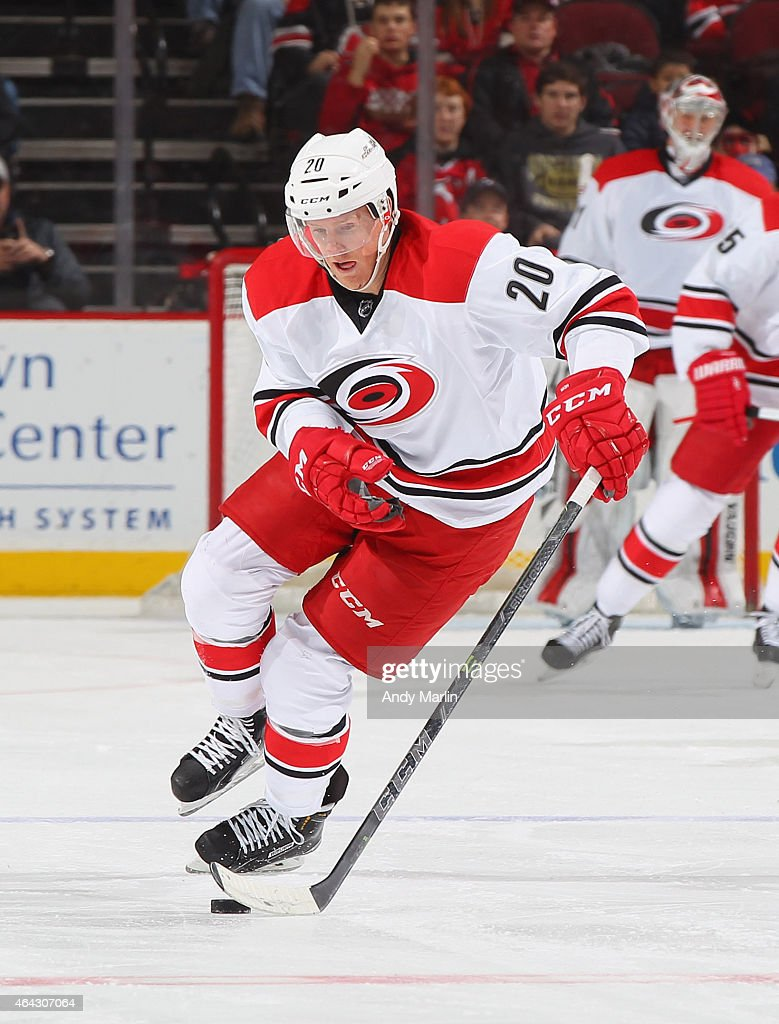 Riley Nash of the Carolina Hurricanes plays the puck during the game against the New Jersey Devils at the Prudential Center on February 21 2015 in...