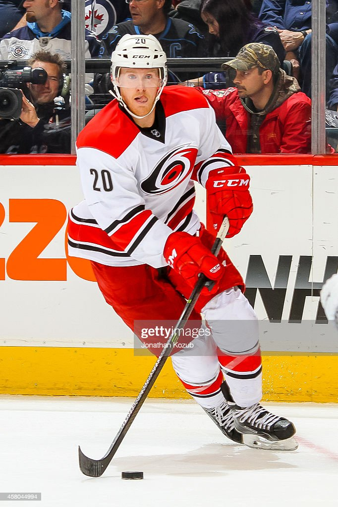 Riley Nash of the Carolina Hurricanes plays the puck up the ice during third period action against the Winnipeg Jets on October 21 2014 at the MTS...