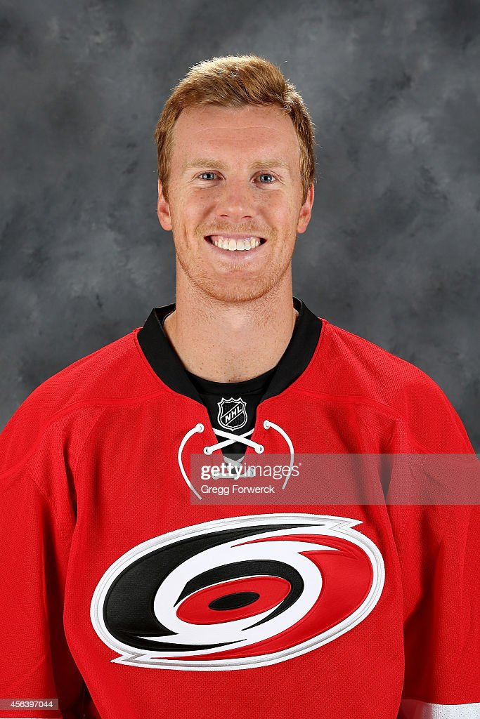 Riley Nash of the Carolina Hurricanes poses for his official headshot for the 20142015 season at Carolina Family Practice on September 18 2014 in...