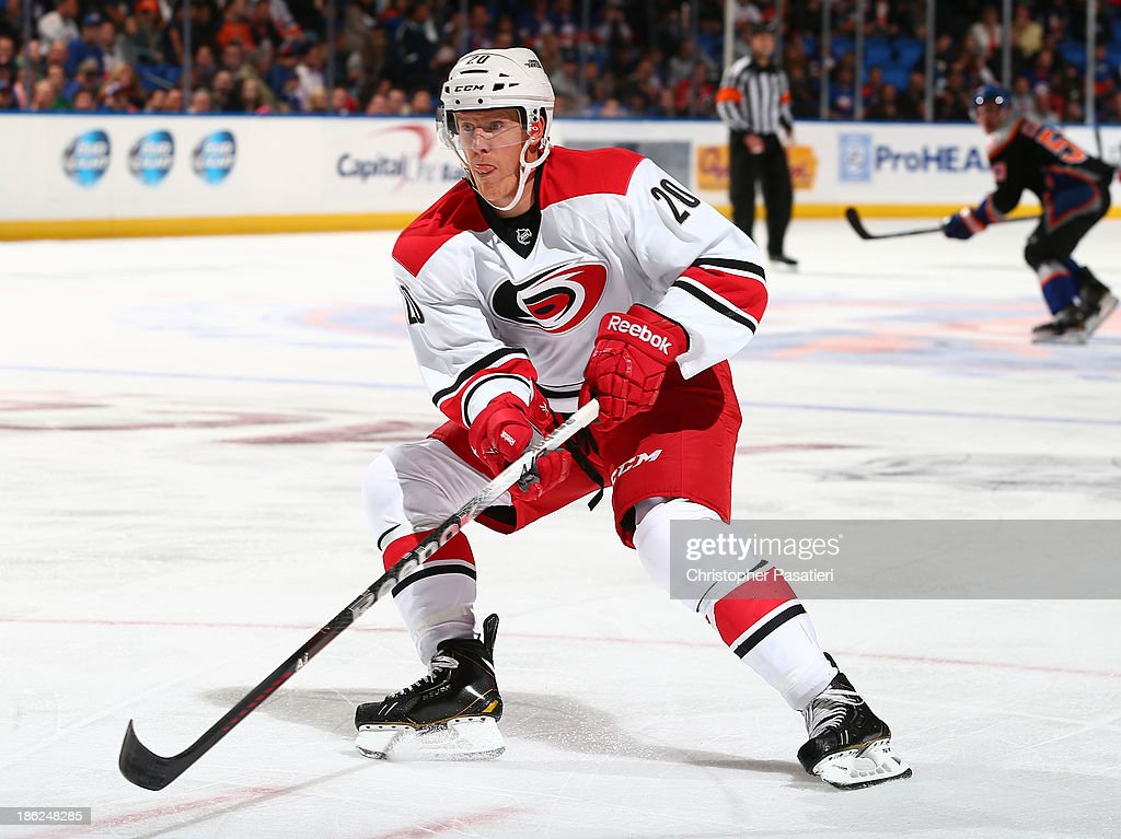 Riley Nash of the Carolina Hurricanes skates during the first period against the New York Islanders on October 19 2013 at the Nassau Veterans...