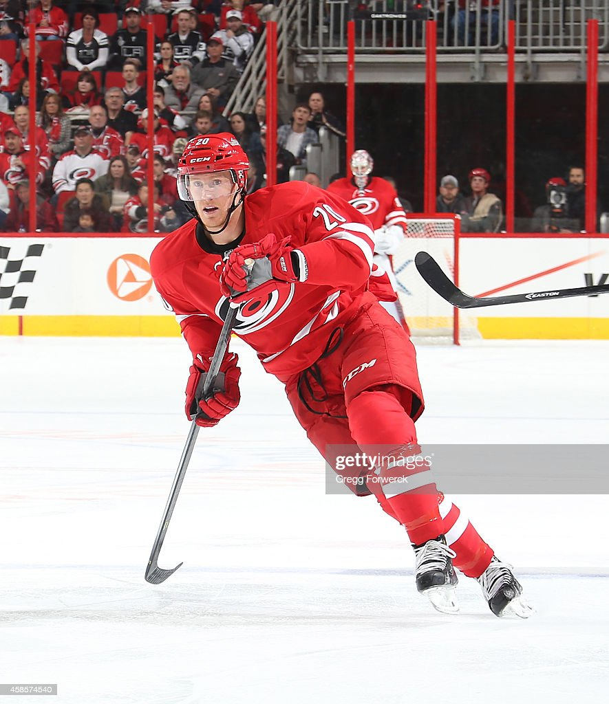 Riley Nash of the Carolina Hurricanes skates for position on the ice during their NHL game against the Los Angeles Kings at PNC Arena on November 2...