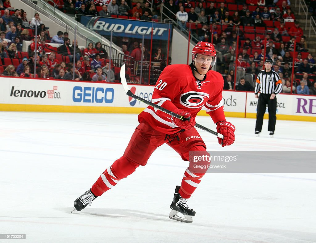 Riley Nash of the Carolina Hurricanes skates for position on the ice during their NHL game against the Vancouver Canucks at PNC Arena on January 16...