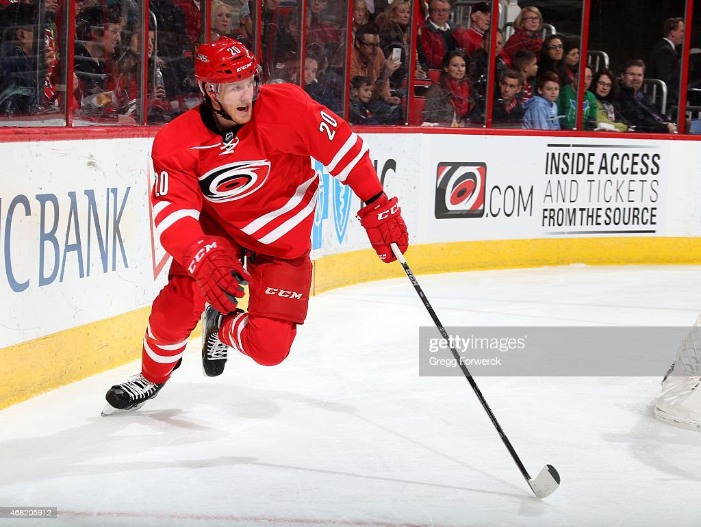 Riley Nash of the Carolina Hurricanes skates for position on the ice behind the net during their NHL game against the New Jersey Devils at PNC Arena...