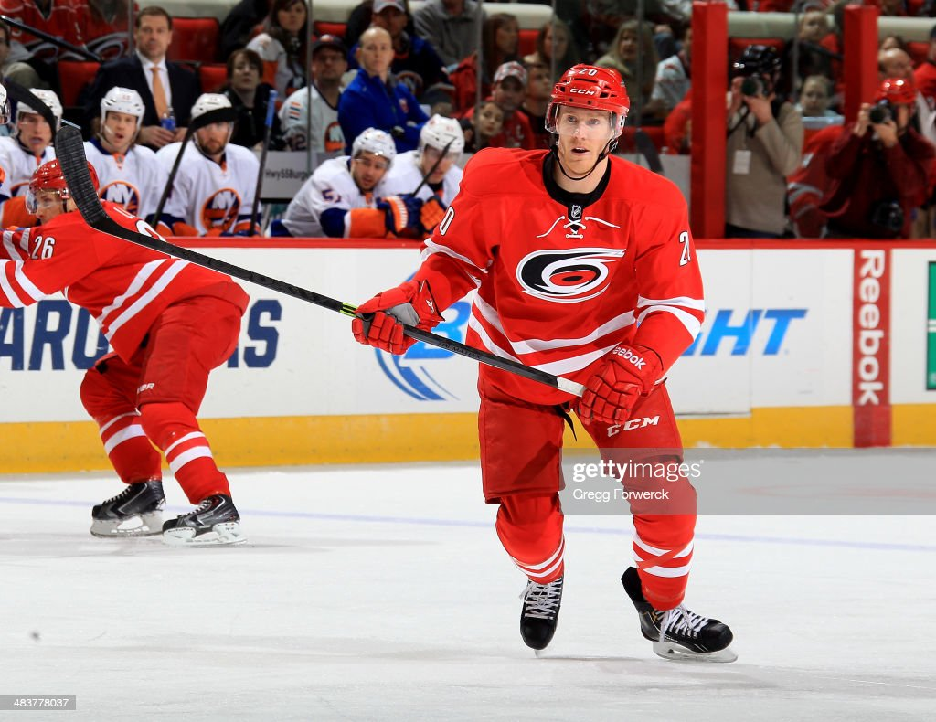 Riley Nash of the Carolina Hurricanes skates for position on the ice during their NHL game against the New York Islanders at PNC Arena on March 25...