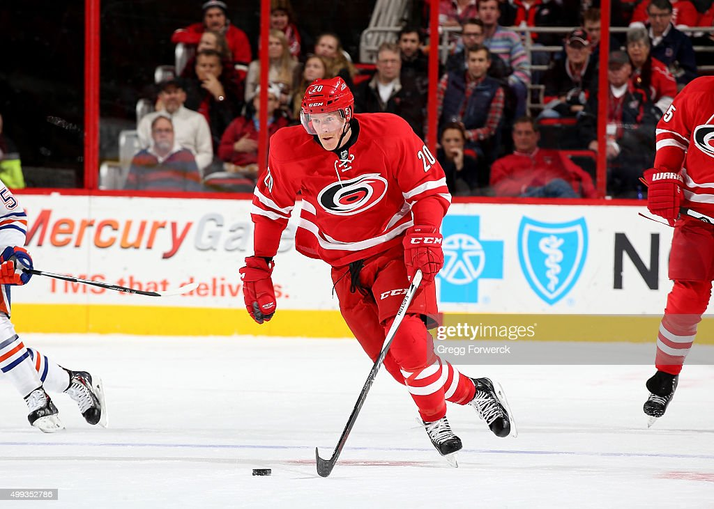Riley Nash of the Carolina Hurricanes skates hard on the ice against the Edmonton Oilers during a NHL game at PNC Arena on November 25 2015 in...