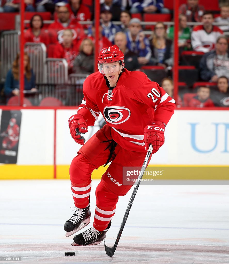 Riley Nash of the Carolina Hurricanes skates with the puck during a NHL game against the Tampa Bay Lightning at PNC Arena on November 1 2015 in...