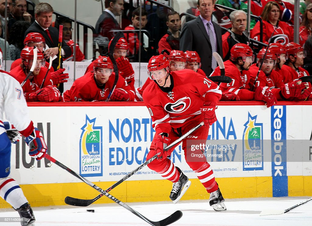 Riley Nash of the Carolina Hurricanes skates with the puck during an NHL game against the Montreal Canadiens at PNC Arena on April 7 2016 in Raleigh...