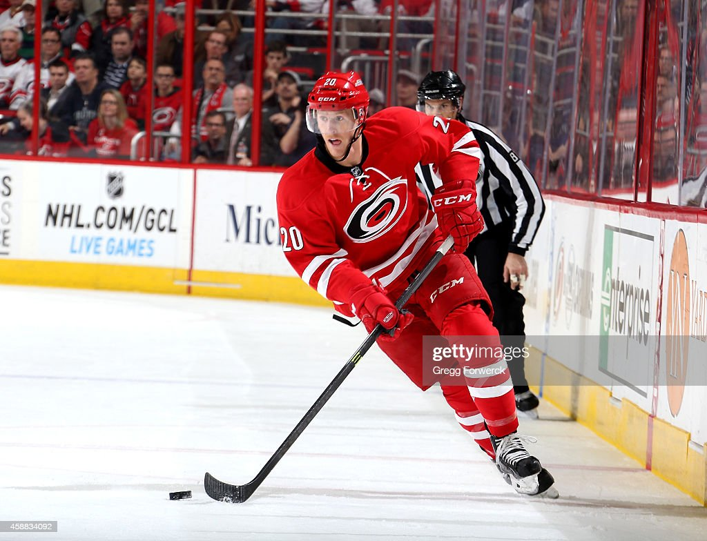 Riley Nash of the Carolina Hurricanes skates with the puck during their NHL game against the Calgary Flames at PNC Arena on November 10 2014 in...
