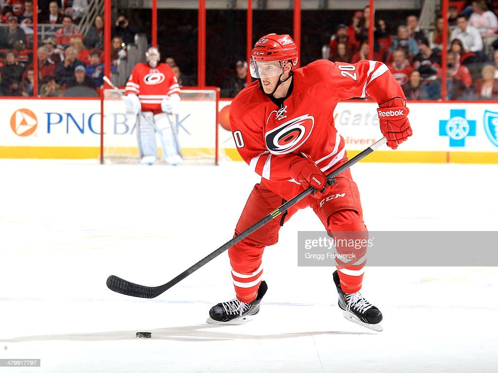 Riley Nash of the Carolina Hurricanes skates with the puck during their NHL game against the Buffalo Sabres at PNC Arena on March 13 2014 in Raleigh...