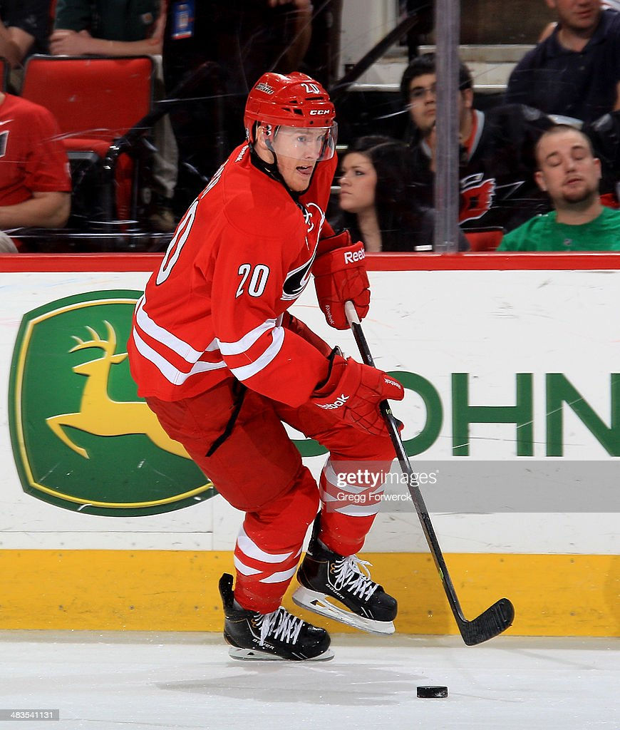 Riley Nash of the Carolina Hurricanes skates with the puck during their NHL game against the Dallas Stars at PNC Arena on April 3 2014 in Raleigh...