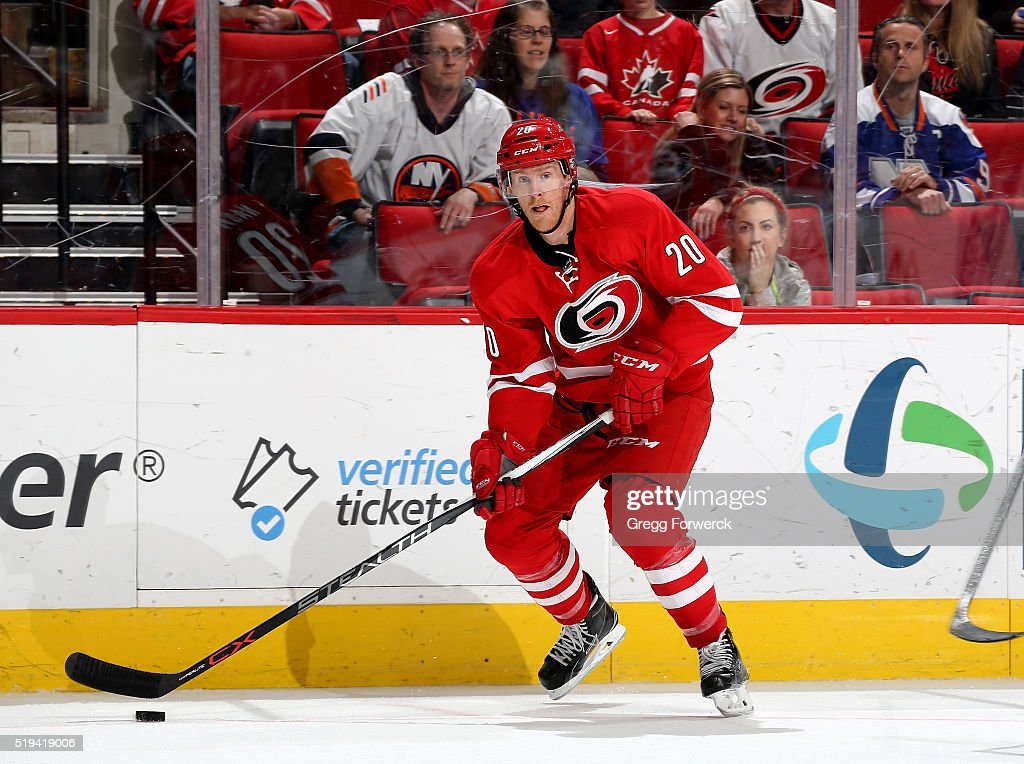 Riley Nash of the Carolina Hurricanes skates with the puck near the boards during an NHL game against the New York Islanders at PNC Arena on March 26...