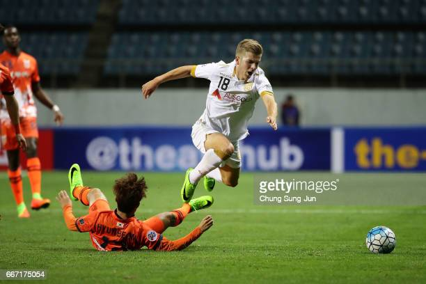 Riley Patrick Mcgree of Adelaide United competes for the ball with Ahn HyunBeom of Jeju United FC during the AFC Champions League Group H match...