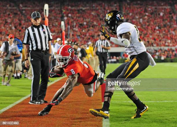 Riley Ridley of the Georgia Bulldogs makes a catch for a 1st quarter touchdown against Anthony Hines of the Missouri Tigers at Sanford Stadium on...