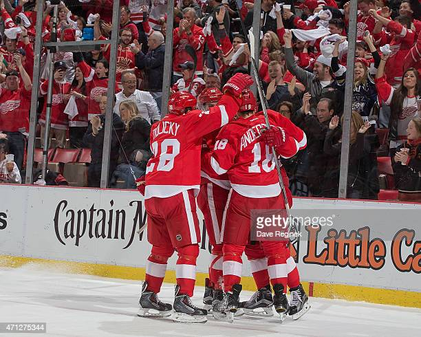 Riley Sheahan and Marek Zidlicky of the Detroit Red Wings congratulate teammate Joakim Andersson on scoring a goal in Game Four of the Eastern...