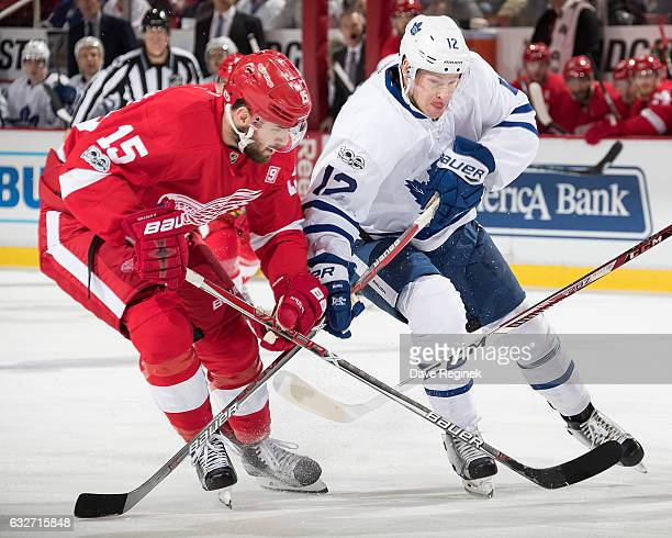 Riley Sheahan of the Detroit Red Wings battles for position with Connor Brown of the Toronto Maple Leafs during an NHL game at Joe Louis Arena on...