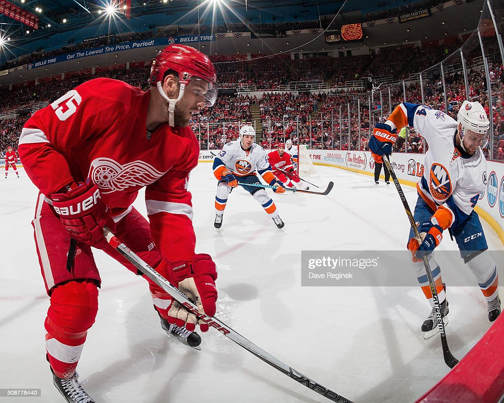 <a gi-track='captionPersonalityLinkClicked' href=/galleries/search?phrase=Riley+Sheahan&family=editorial&specificpeople=7029365 ng-click='$event.stopPropagation()'>Riley Sheahan</a> #15 of the Detroit Red Wings battles for the puck in the corner with <a gi-track='captionPersonalityLinkClicked' href=/galleries/search?phrase=Calvin+de+Haan&family=editorial&specificpeople=5660177 ng-click='$event.stopPropagation()'>Calvin de Haan</a> #44 of the New York Islanders during an NHL game at Joe Louis Arena on February 6, 2016 in Detroit, Michigan.