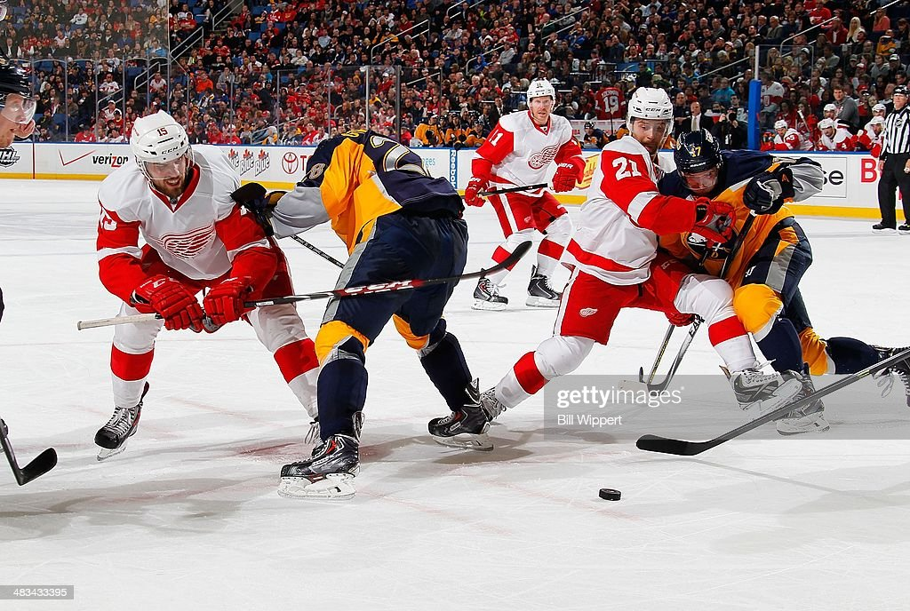 <a gi-track='captionPersonalityLinkClicked' href=/galleries/search?phrase=Riley+Sheahan&family=editorial&specificpeople=7029365 ng-click='$event.stopPropagation()'>Riley Sheahan</a> #15 of the Detroit Red Wings battles <a gi-track='captionPersonalityLinkClicked' href=/galleries/search?phrase=Zemgus+Girgensons&family=editorial&specificpeople=8050732 ng-click='$event.stopPropagation()'>Zemgus Girgensons</a> #28 of the Buffalo Sabres while teammate <a gi-track='captionPersonalityLinkClicked' href=/galleries/search?phrase=Tomas+Tatar&family=editorial&specificpeople=5652303 ng-click='$event.stopPropagation()'>Tomas Tatar</a> #21 battles with <a gi-track='captionPersonalityLinkClicked' href=/galleries/search?phrase=Torrey+Mitchell&family=editorial&specificpeople=4504539 ng-click='$event.stopPropagation()'>Torrey Mitchell</a> #17 of the Sabres following a faceoff on April 8, 2014 at the First Niagara Center in Buffalo, New York.