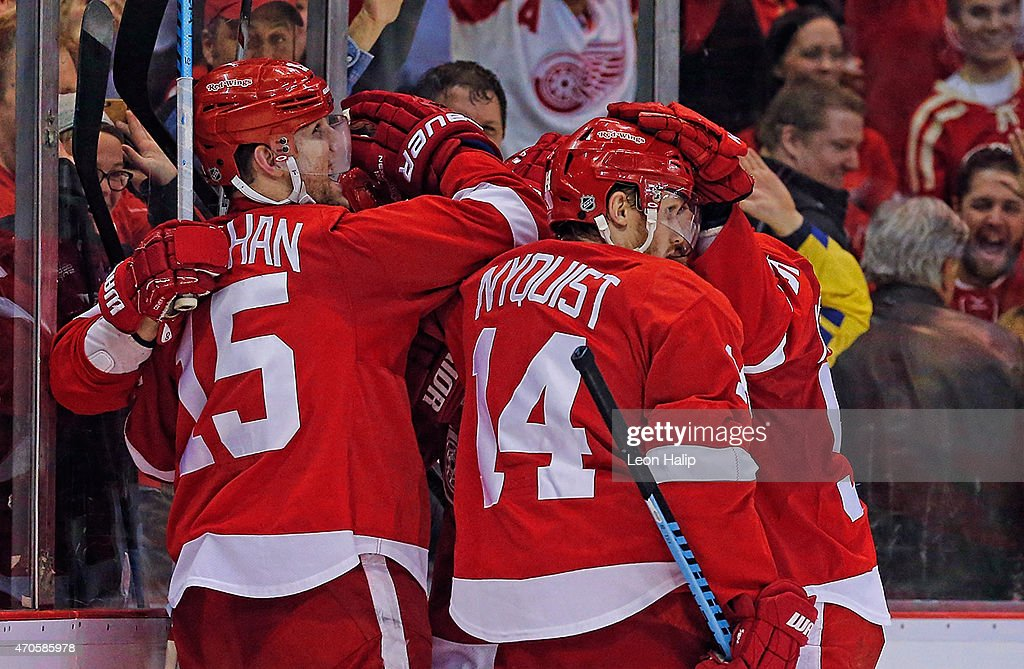 Riley Sheahan #15 of the Detroit Red Wings celebrates with his teammates after scoring a third period goal against the Tampa Bay Lightning in Game Three of the Eastern Conference Quarterfinals during the 2015 NHL Stanley Cup Playoffs on April 21, 2015 at Joe Louis Arena in Detroit, Michigan. The Red Wings defeated the Lightning 3-0.