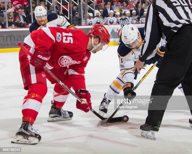 Riley Sheahan of the Detroit Red Wings faces off against Evan Rodrigues of the Buffalo Sabres during an NHL game at Joe Louis Arena on March 20 2017...