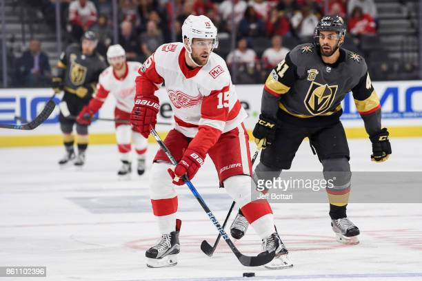 Riley Sheahan of the Detroit Red Wings handles the puck with PierreEdouard Bellemare of the Vegas Golden Knights defending during the game at TMobile...