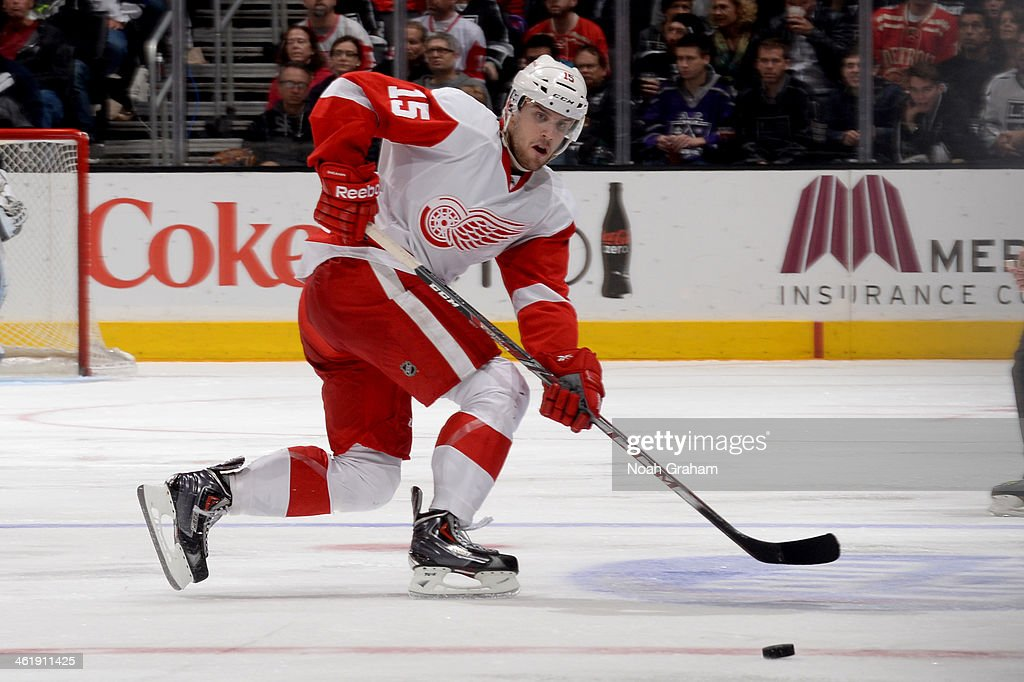 <a gi-track='captionPersonalityLinkClicked' href=/galleries/search?phrase=Riley+Sheahan&family=editorial&specificpeople=7029365 ng-click='$event.stopPropagation()'>Riley Sheahan</a> #15 of the Detroit Red Wings passes the puck against the Los Angeles Kings at Staples Center on January 11, 2014 in Los Angeles, California.
