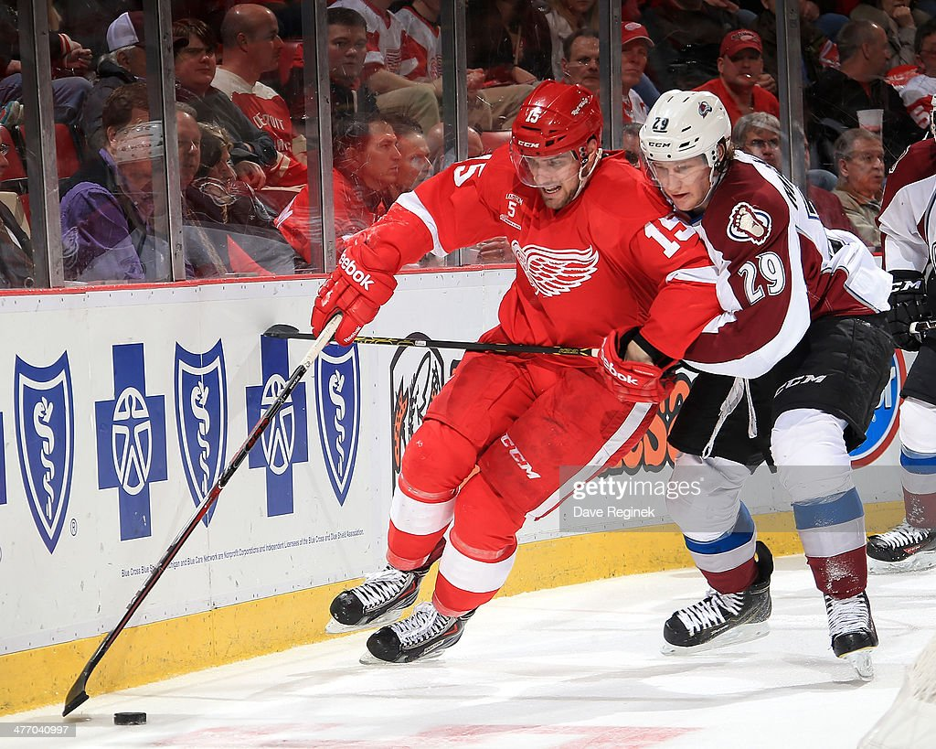 <a gi-track='captionPersonalityLinkClicked' href=/galleries/search?phrase=Riley+Sheahan&family=editorial&specificpeople=7029365 ng-click='$event.stopPropagation()'>Riley Sheahan</a> #15 of the Detroit Red Wings protects the puck as <a gi-track='captionPersonalityLinkClicked' href=/galleries/search?phrase=Nathan+MacKinnon&family=editorial&specificpeople=8610127 ng-click='$event.stopPropagation()'>Nathan MacKinnon</a> #29 of the Colorado Avalanche defends during an NHL game on March 6, 2014 at Joe Louis Arena in Detroit, Michigan.