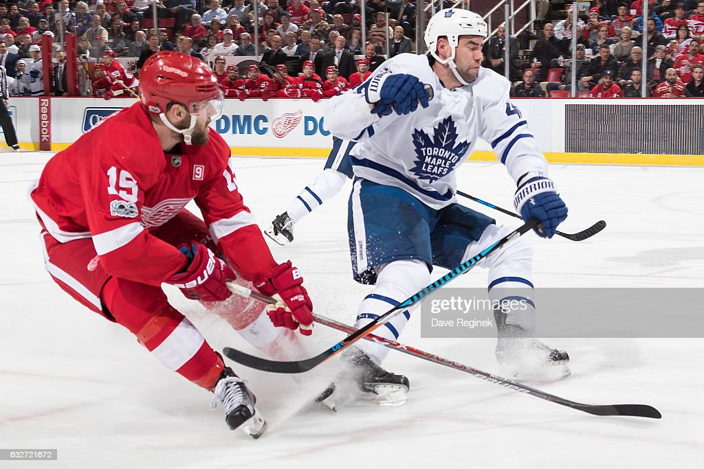 Riley Sheahan #15 of the Detroit Red Wings races into Roman Polak #46 of the Toronto Maple Leafs during an NHL game at Joe Louis Arena on January 25, 2017 in Detroit, Michigan.